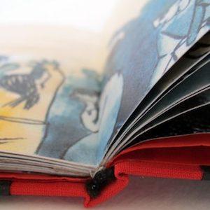 encuadernación de un libro ilustrado